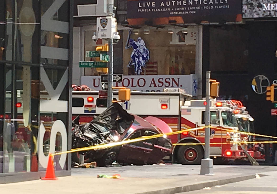 A smashed car sits on the corner of Broadway and 45th Street in New York's Times Square after driving through a crowd of pedestrians Thursday, May 18, 2017. (Seth Wenig/AP)