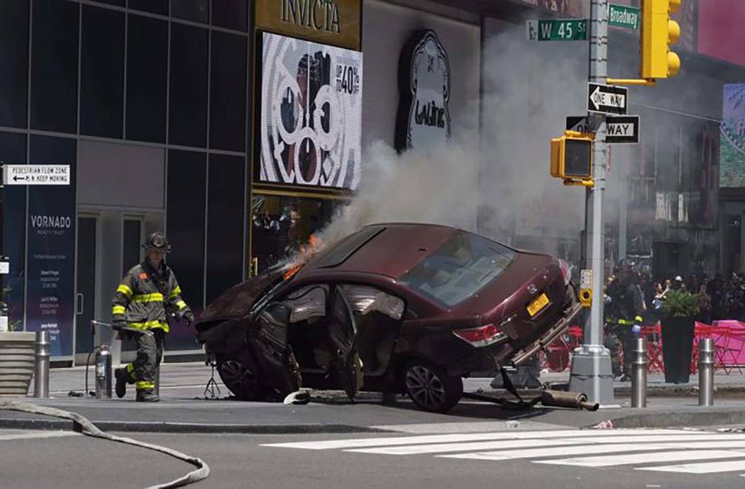 A speeding vehicle struck pedestrians on a sidewalk in New York City's Times Square on Thursday, May 18, 2017. (Twitter/@The Odyssey)