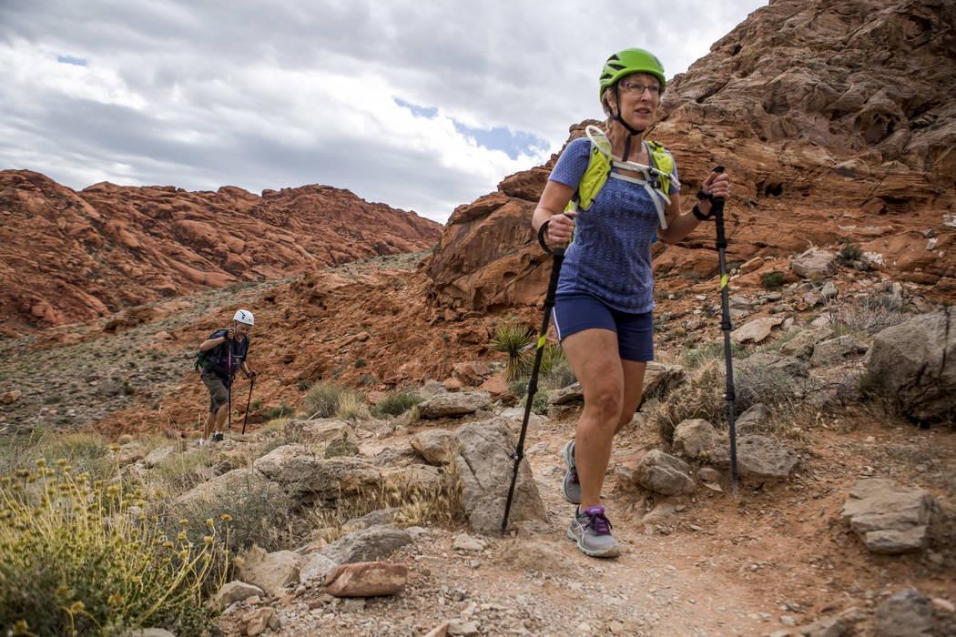 Candace Kawatsu hikes with her friend Rob Hays on the Kraft Mountain Loop trail in Calico Basin on Thursday, May 18, 2017. Patrick Connolly Las Vegas Review-Journal @PConnPie