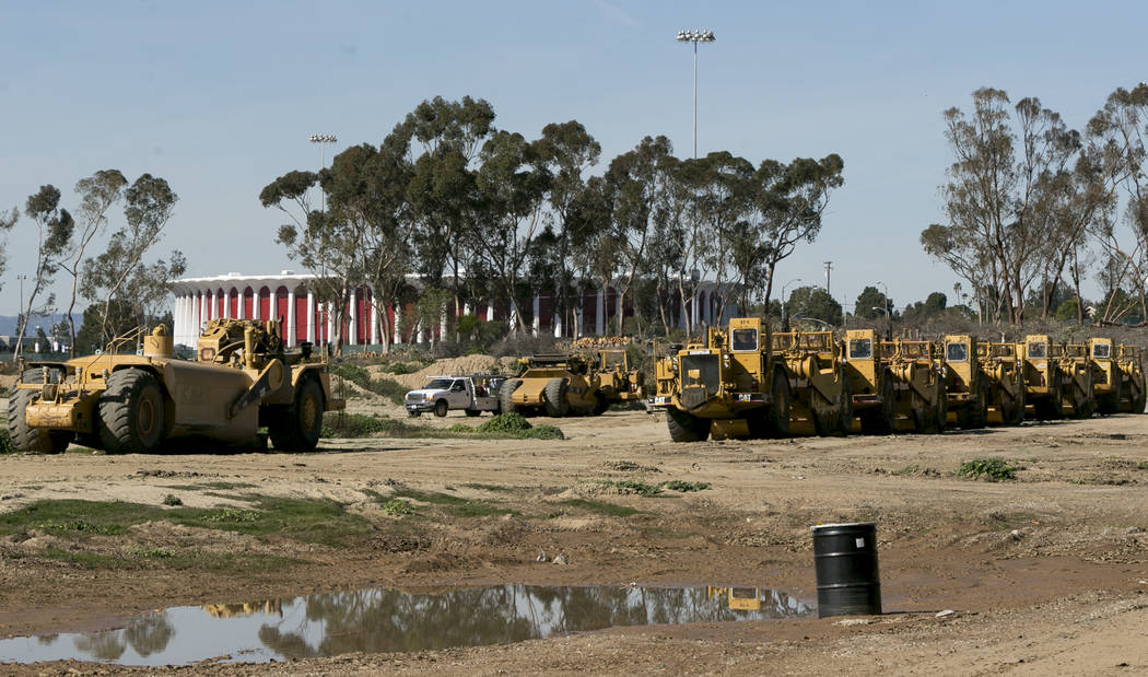 This Feb. 3, 2016, file photo shows heavy machinery adjacent to the proposed NFL team Los Angeles Rams stadium complex site at Hollywood Park in Inglewood, Calif. The opening date for the $2.6 bil ...