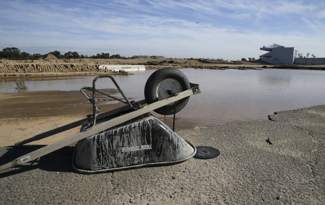 In this Jan. 13, 2016, file photo, a wheelbarrow sits at the site of the former Hollywood Park in Inglewood, Calif., where a stadium for NFL football Los Angeles Rams is being built. The opening d ...