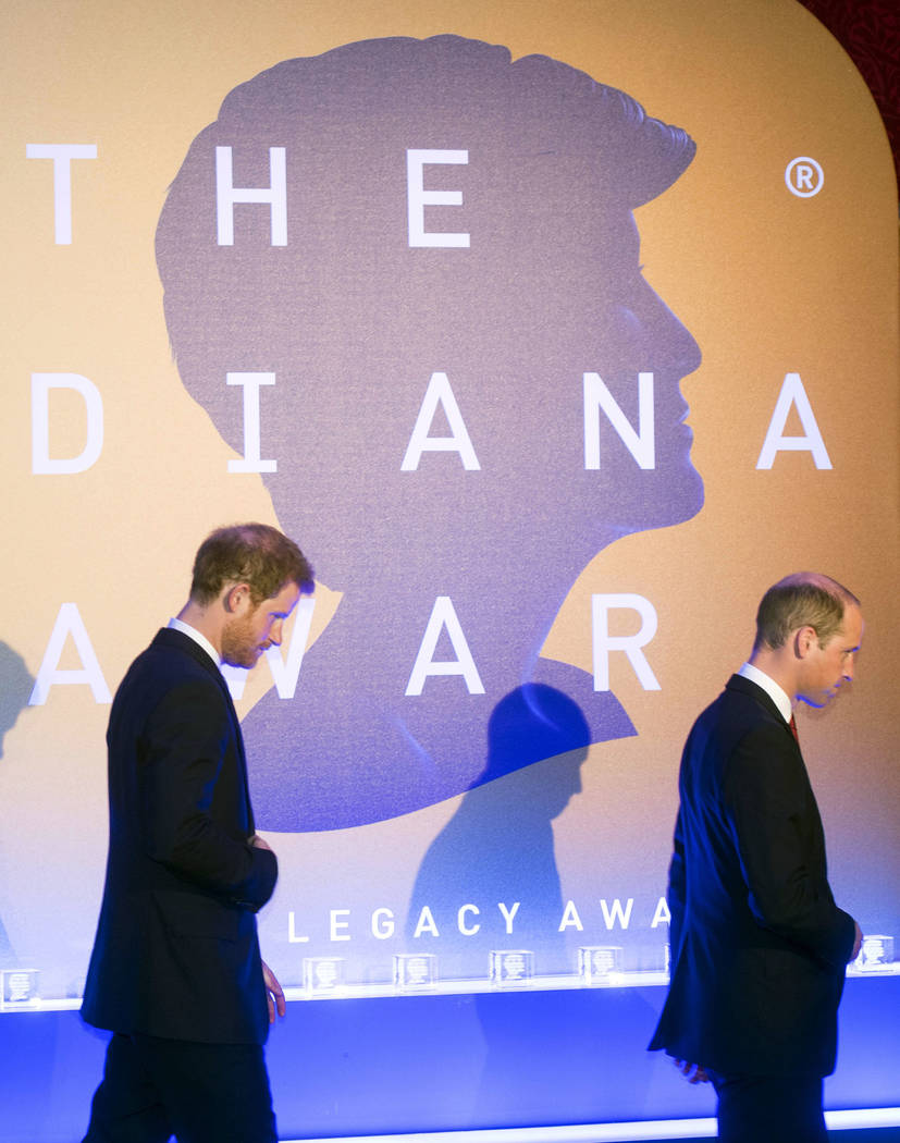 Britain's Prince Harry, left, and Prince William arrive on stage during a ceremony The Diana Award's inaugural Legacy Award, at St James' Palace in London, Thursday, May 18, 2017.  (Paul Grover/Po ...
