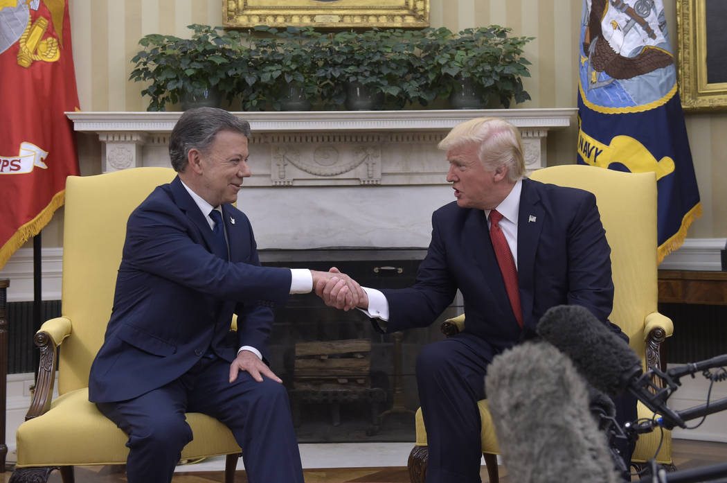 President Donald Trump meets with Colombian President Juan Manuel Santos in the Oval Office of the White House in Washington, Thursday, May 18, 2017. (Susan Walsh/AP)