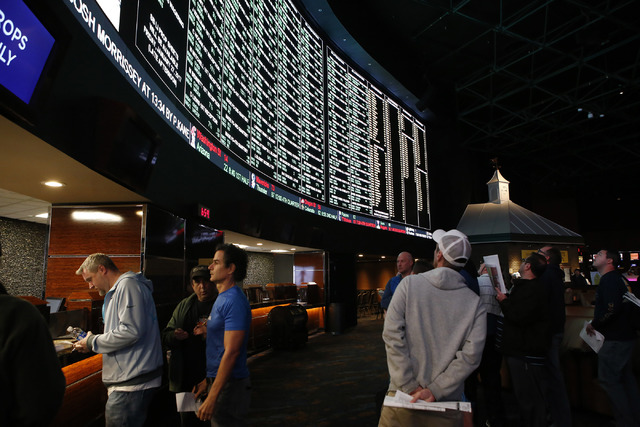Betters looks at a tv screen while standing in line to place their bets at the Westgate sports book on Thursday, Jan. 26, 2017, in Las Vegas. (Christian K. Lee/Las Vegas Review-Journal) @chrisklee ...