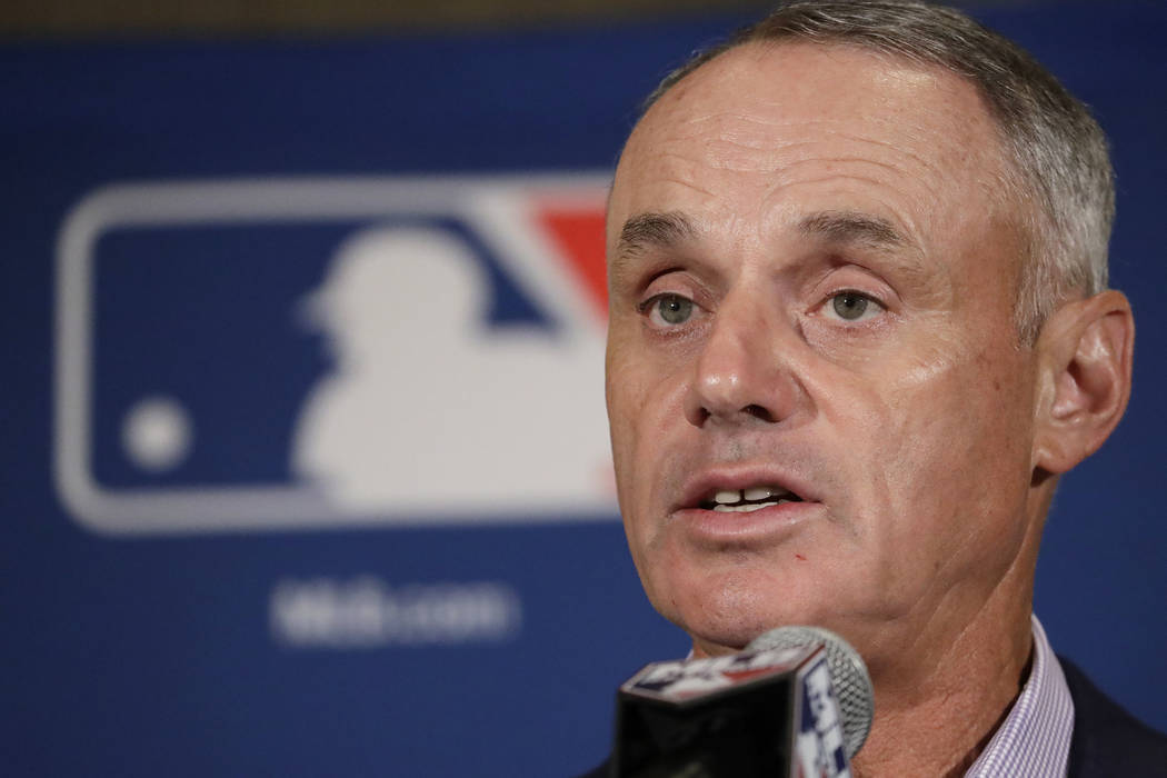 In this Feb. 21, 2017, file photo, Major League Baseball Commissioner Rob Manfred answers questions at a news conference in Phoenix. Baseball fans can like their team's games with a click starting ...