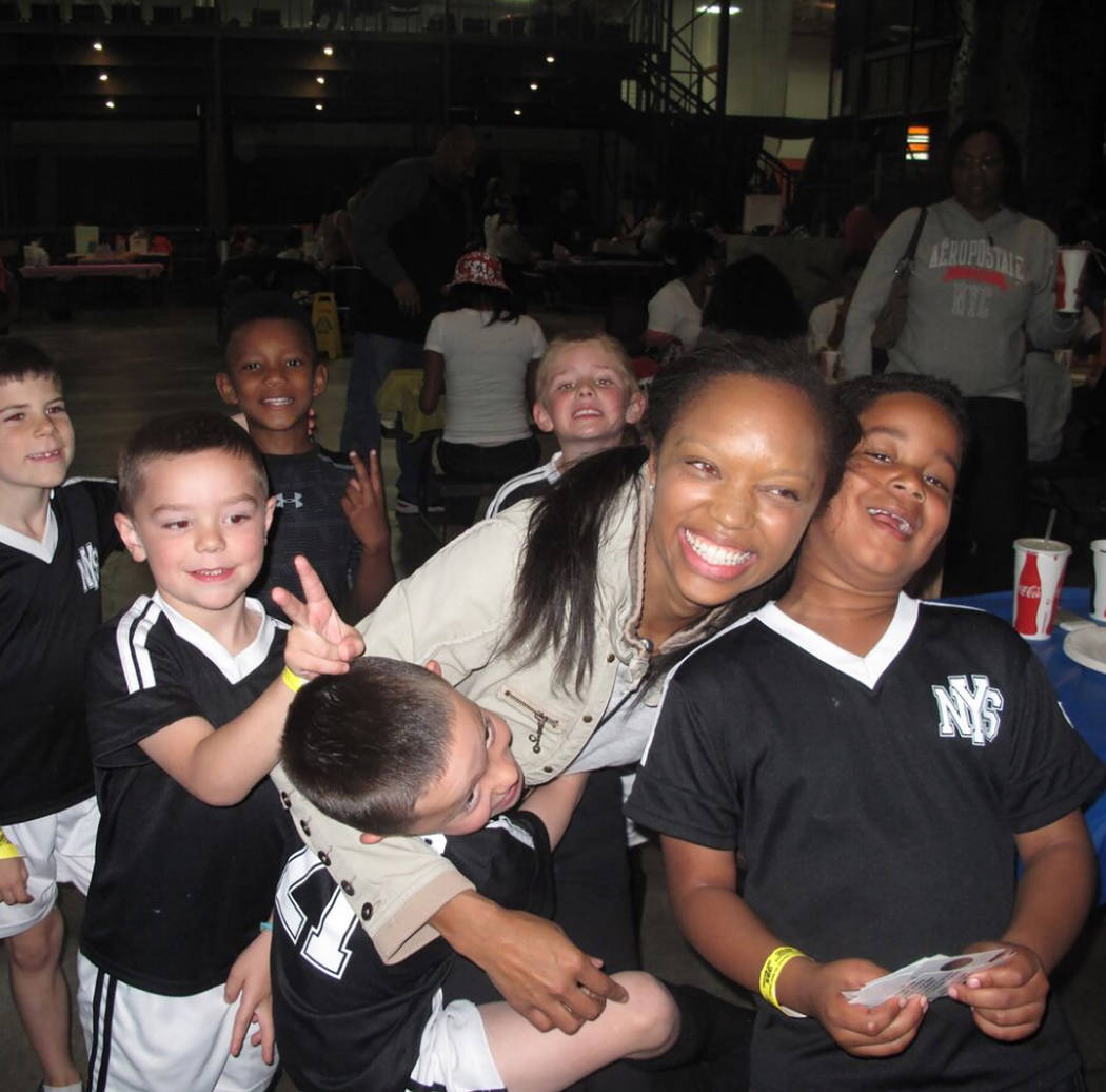 Coach Michelle Douglas is seen with members of one of her youth soccer teams. (Courtesy)