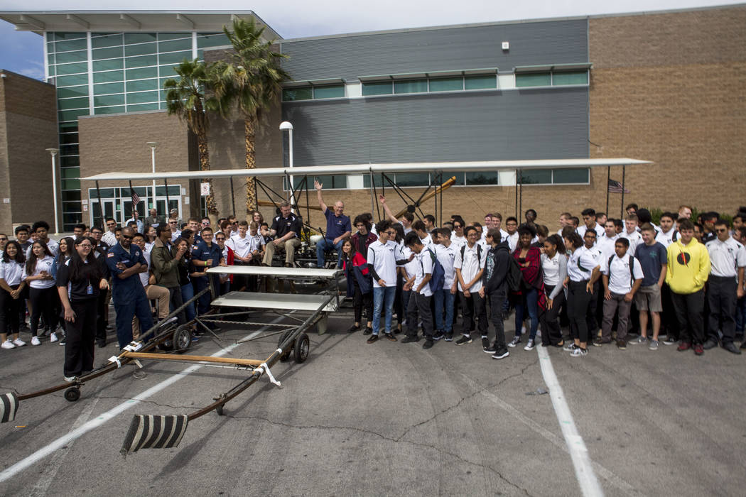 Aviation students gather around a full-size replica of the 1905 Wright Brothers Flyer at Rancho High School in Las Vegas on Monday, May 15, 2017. The model, originally designed and built by Univer ...