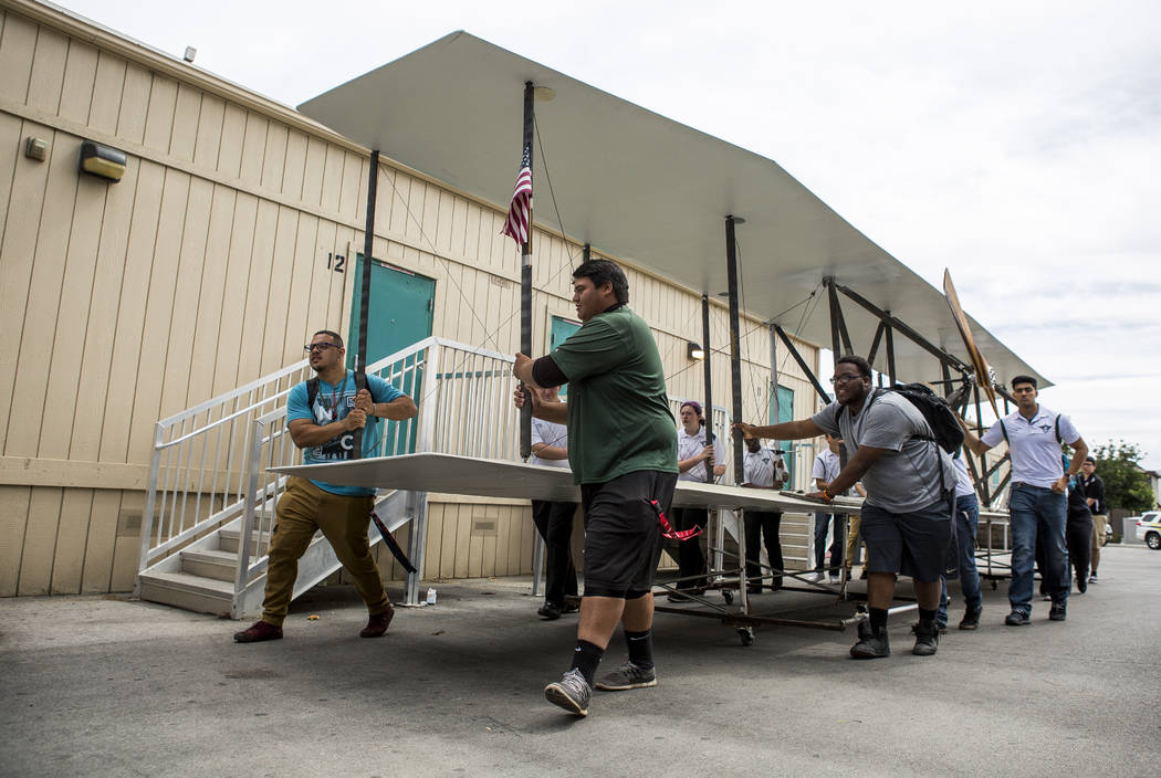 Aviation students transport the wings of a full-size replica of the 1905 Wright Brothers Flyer at Rancho High School in Las Vegas on Monday, May 15, 2017. The model, originally designed and built  ...