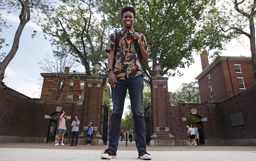 Obasi Shaw poses outside the gates of Harvard Yard in Cambridge, Mass., Thursday, May 18, 2017. (Charles Krupa/AP)