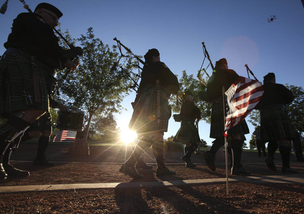 Bagpipers with the Multi-Jurisdictional Honor Guard lead a procession during the annual Southern Nevada Law Enforcement Memorial at Police Memorial Park in Las Vegas on Thursday, May 18, 2017. The ...