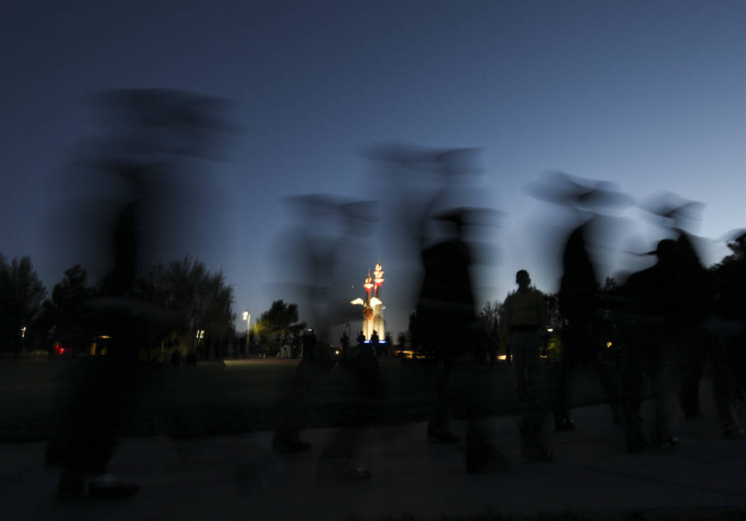 Members of the Multi-Jurisdictional Honor Guard are silhouetted at dusk during the annual Southern Nevada Law Enforcement Memorial at Police Memorial Park in Las Vegas on Thursday, May 18, 2017. T ...