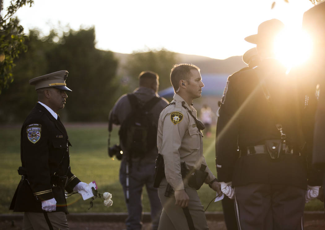 Law enforcement officers carry roses for fallen officers during the annual Southern Nevada Law Enforcement Memorial at Police Memorial Park in Las Vegas on Thursday, May 18, 2017. The year's multi ...