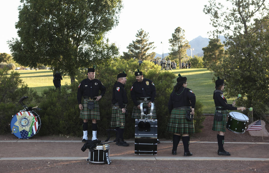 Members of the Multi-Jurisdictional Honor Guard prepare for the start of the annual Southern Nevada Law Enforcement Memorial at Police Memorial Park in Las Vegas on Thursday, May 18, 2017. The yea ...