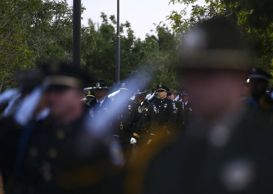 Members of the Multi-Jurisdictional Honor Guard salute during the annual Southern Nevada Law Enforcement Memorial at Police Memorial Park in Las Vegas on Thursday, May 18, 2017. The year's multi-a ...