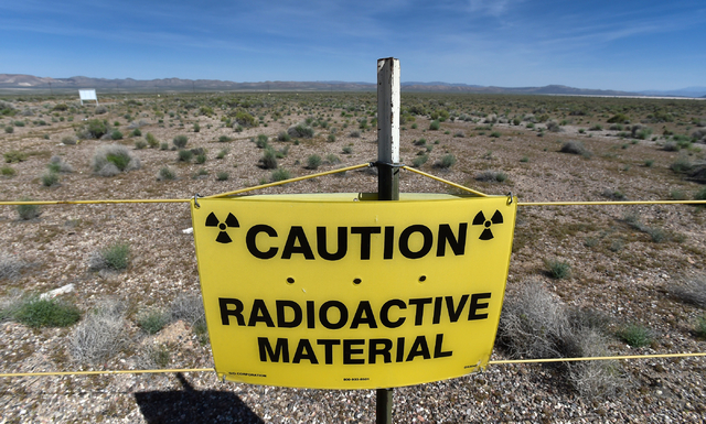 A warning sign is displayed at the Counter-Terrorism Operations Support training facility near the blast site from the 1955 Apple II nuclear bomb test at the Nevada National Security Site on Wedne ...