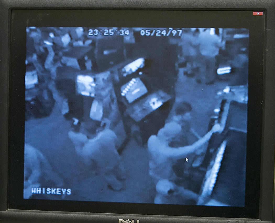 Jeremy Strohmeyer, wearing a cap, and David Cash Jr. are seen in surveillance footage played in the evidence vault at the Regional Justice Center on Friday, May 12, 2017, in Las Vegas. Twenty year ...