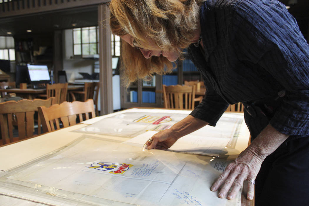 In this Tuesday, May 9, 2017, photo University of New Mexico associate professor of sculpture Ellen Babcock examines one of the neon design sketches she found among old business files belonging to ...