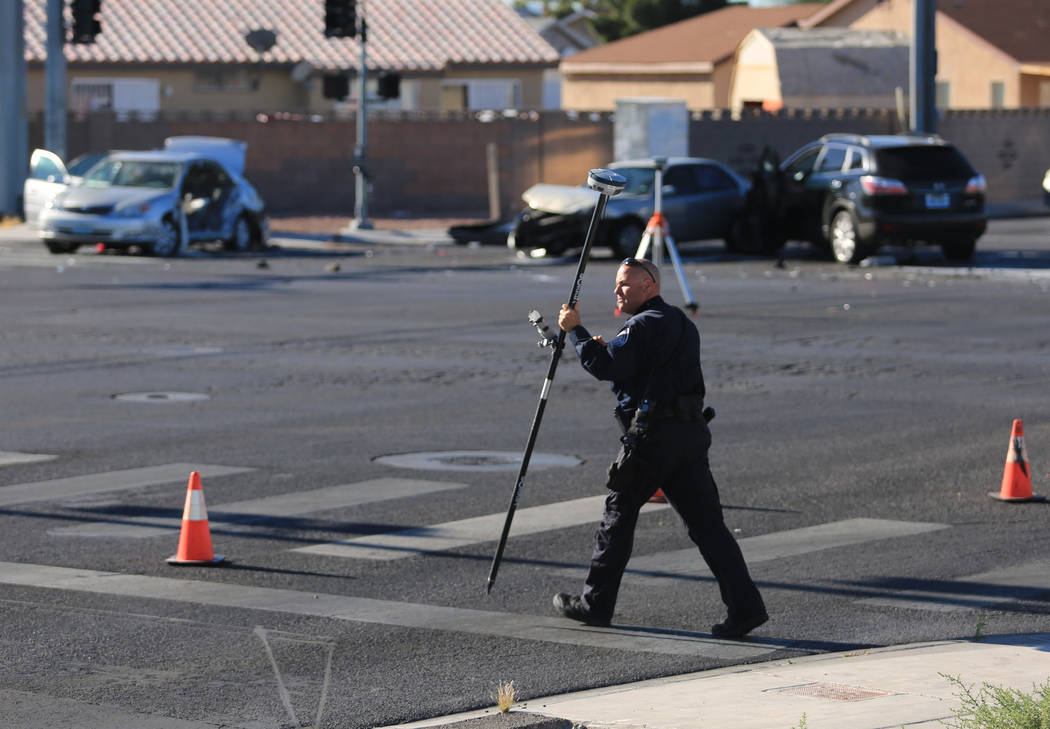 North Las Vegas police investigate a crash at the intersection of Carey Avenue and Simmons Street in North Las Vegas on Friday, May 19, 2017. (Brett Le Blanc Las Vegas Review-Journal) @bleblancphoto