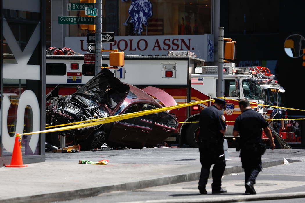 A smashed car sits on the corner of Broadway and 45th Street in New York's Times Square after ploughing through a crowd of pedestrians at lunchtime on Thursday, May 18, 2017. (Seth Wenig/AP)