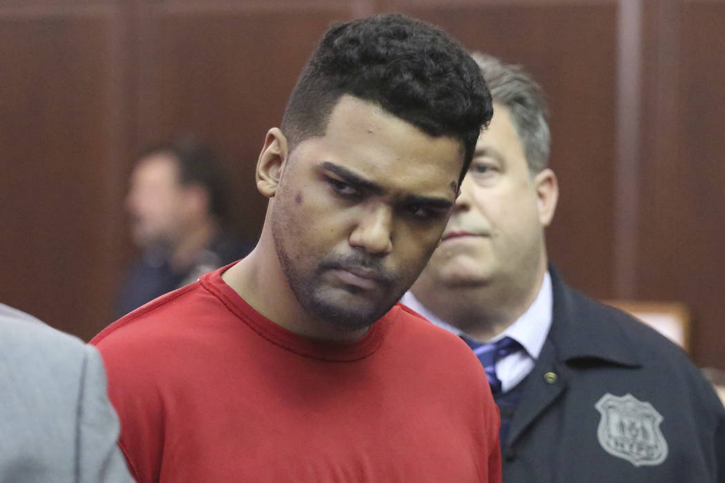 Richard Rojas, of the Bronx, N.Y., accused of mowing down a crowd of Times Square pedestrians, killing a teenage tourist, appears for his arraignment in Manhattan Criminal Court, in New York, Frid ...