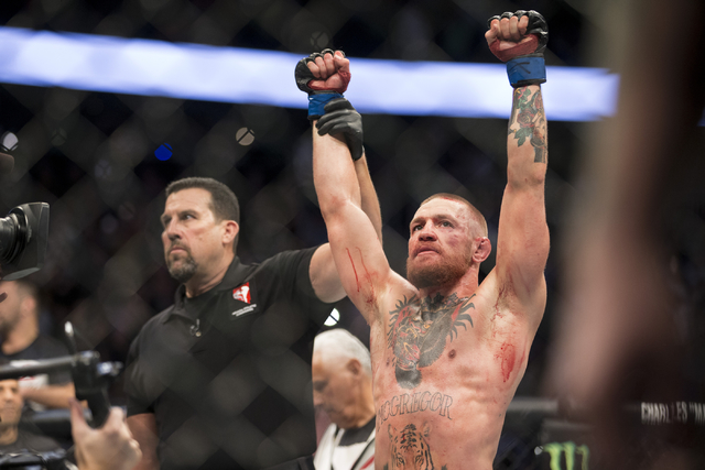 Conor McGregor raises his arms in victory against Nate Diaz in the welterweight bout during UFC 202 at T-Mobile Arena on Saturday, Aug. 20, 2016, in Las Vegas. McGregor won by majority decision.   ...
