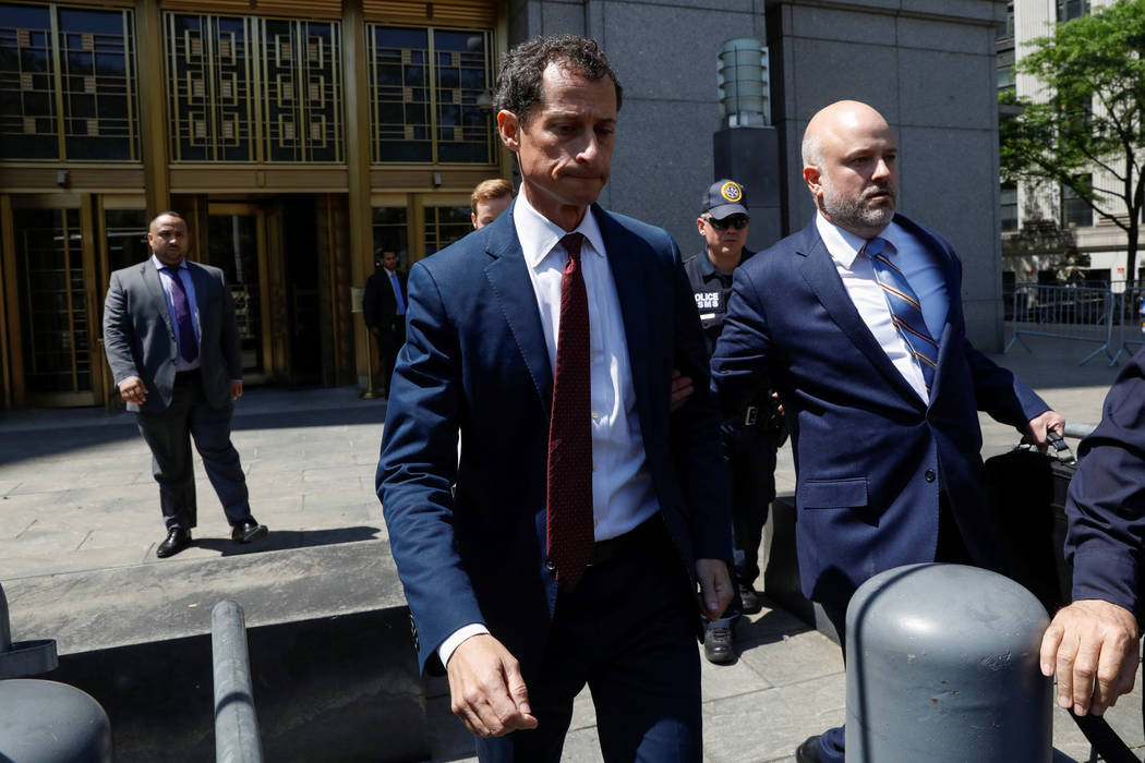 "Former U.S. Congressman Anthony Weiner exits U.S. Federal Court, after pleading guilty to one count of sending obscene messages to a minor, ending an investigation into a ""sexting"" scandal that pl ..."