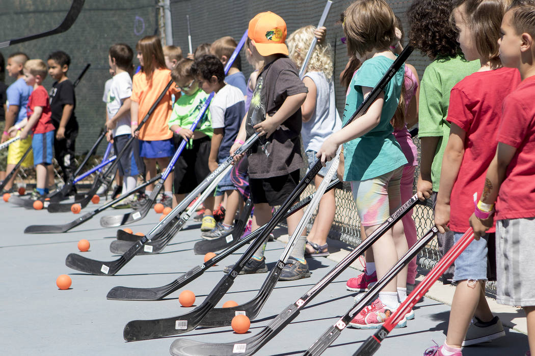 "Kids participate in ""Sticks For Kids,"" a street hockey clinic put on by the Vegas Golden Knights, at Paradise Park on Saturday, May 20, 2017 in Las Vegas. Bridget Bennett Las Vegas Review-Journal  ..."