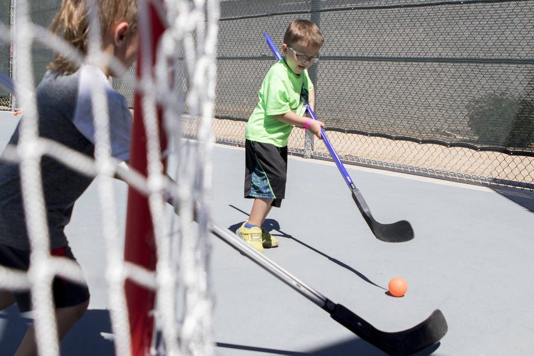 "Gavin Ellis, 5, practices his shooting skills at ""Sticks For Kids,"" a street hockey clinic put on by the Vegas Golden Knights, at Paradise Park on Saturday May 20, 2017, in Las Vegas. Bridget Benn ..."