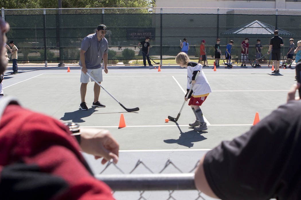 "Parents watch as kids practice at ""Sticks For Kids,"" a street hockey clinic put on by the Vegas Golden Knights, at Paradise Park on Saturday, May 20, 2017 in Las Vegas. Bridget Bennett Las Vegas R ..."