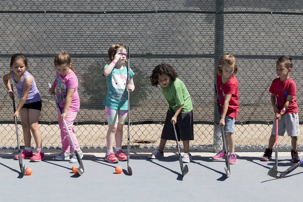 "Kids practice handling the ball at ""Sticks For Kids,"" a street hockey clinic put on by the Vegas Golden Knights, at Paradise Park on Saturday, May 20, 2017 in Las Vegas. Bridget Bennett Las Vegas  ..."