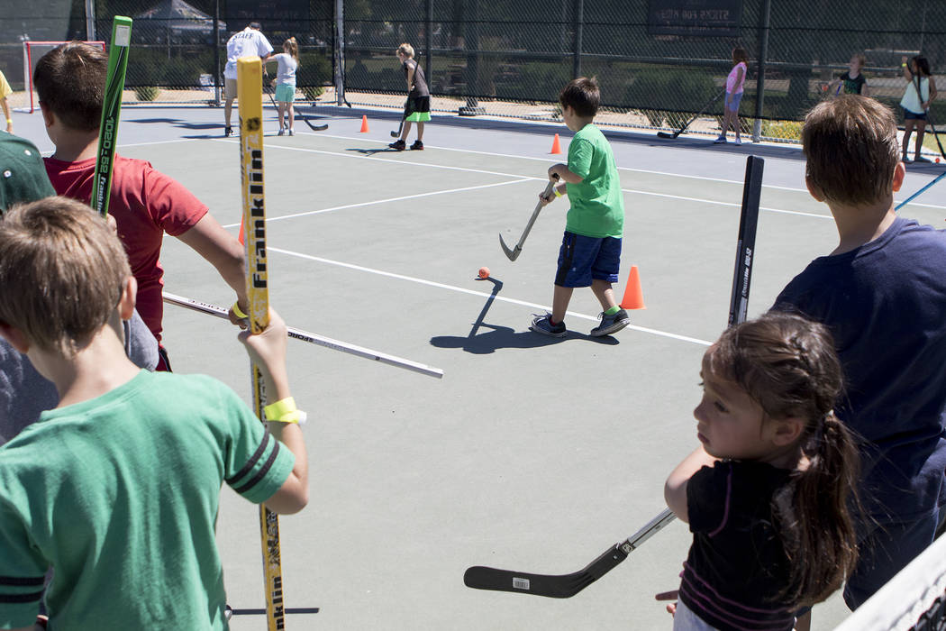 "Kids practice their street hockey skills at ""Sticks For Kids,"" a street hockey clinic put on by the Vegas Golden Knights, at Paradise Park on Saturday, May 20, 2017 in Las Vegas. Bridget Bennett L ..."