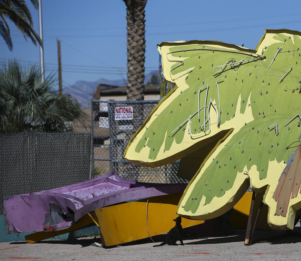 A cat roams around after a Polynesian hotel-casino sign that was kept in storage was installed at the Neon Museum in Las Vegas on Friday, May 19, 2017. The sign is one of approximately 30 in stora ...