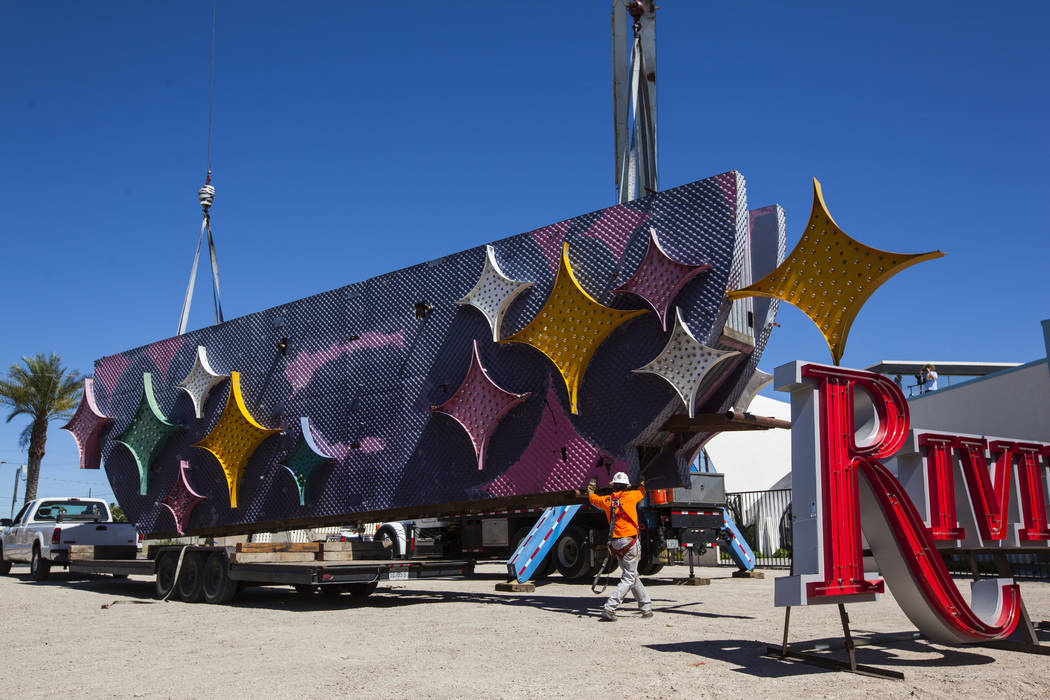Charles Partridge of Federal Health, a visual communications company, helps install part of the Stardust hotel-casino sign at the Neon Museum in Las Vegas on Friday, May 19, 2017. The sign is one  ...