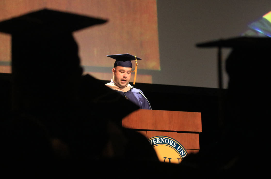 Graduates of Western Governors University Nevada watch graduate speaker Logan McDaniel give his speech at the Smiths Center for the Performing Arts, Saturday, May 20, 2017. Gabriella Benavidez Las ...