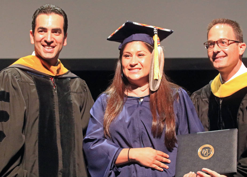 U.S. Rep. Ruben Kihuen, D-Nev., left, poses with Carrie Brown and Western Governors University Nevada chancellor Dr. Spencer Stewart during the WGU Nevada graduation ceremony at the Smiths Center  ...