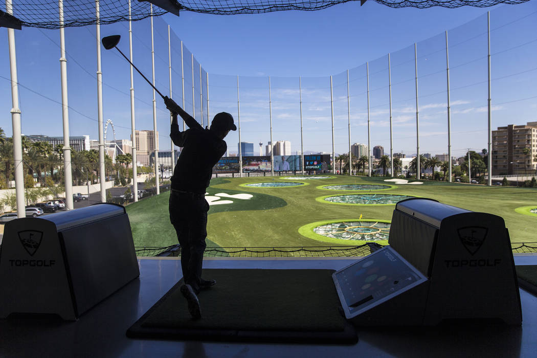Andrew Brickey tees off at Topgolf Las Vegas on Monday, April 10, 2017, at the MGM Grand hotel/casino, in Las Vegas. Benjamin Hager Las Vegas Review-Journal @benjaminhphoto