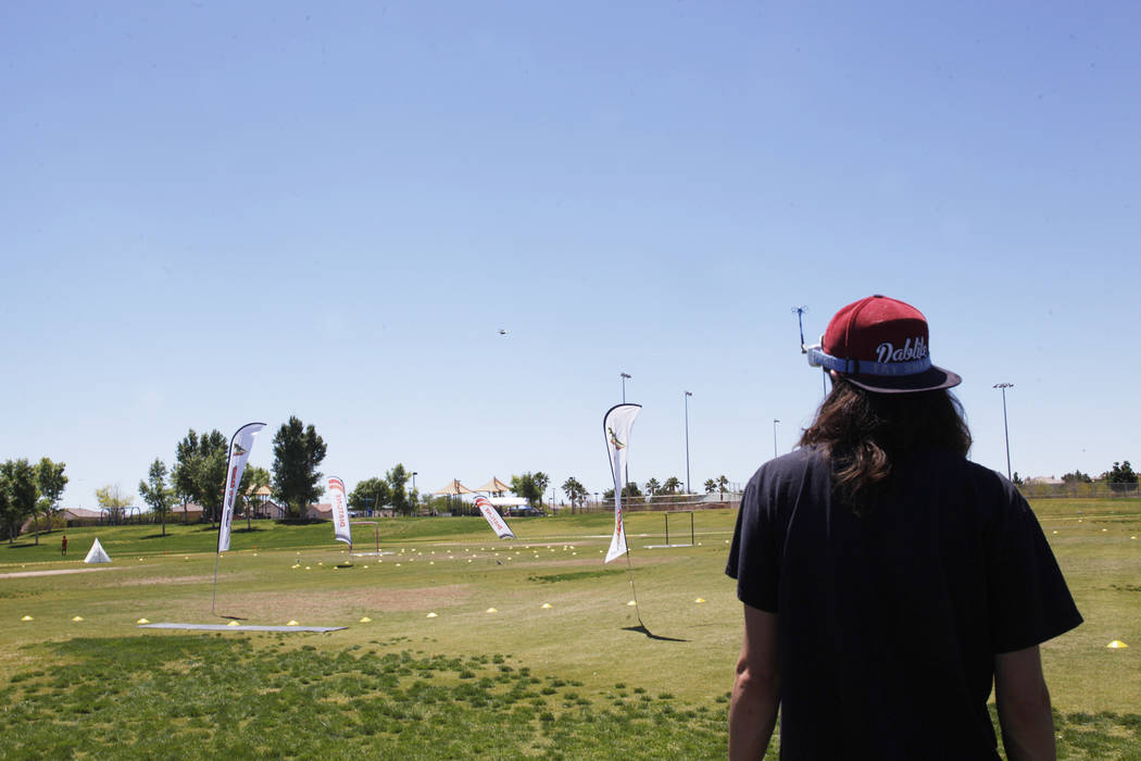 Jonathan Rincon watches drones navigate the course at the King of Las Vegas drone tournament hosted by the Las Vegas Drone Club on Sunday, May 21, 2017, at Red Ridge Park in Las Vegas. Rachel Asto ...