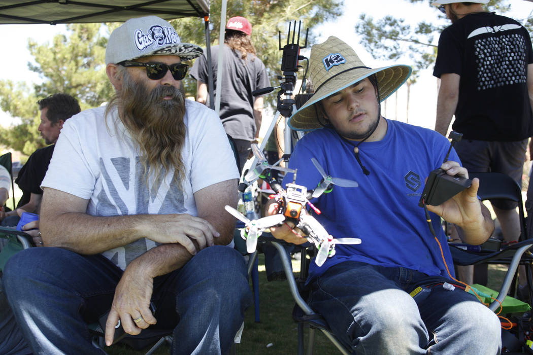 Ian Dent, left, and Zeb Bartlett talk about drones at the King of Las Vegas drone tournament hosted by the Las Vegas Drone Club on Sunday, May 21, 2017, at Red Ridge Park in Las Vegas. Rachel Asto ...