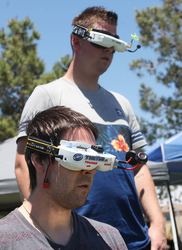Tyler Shane, left, participates in qualifying rounds as his spotter James Older watches at the King of Las Vegas drone tournament hosted by the Las Vegas Drone Club on Sunday, May 21, 2017, at Red ...