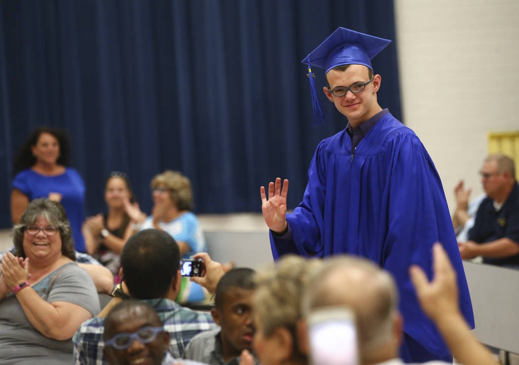 Stephen Ladwig waves to family members during Helen J. Stewart School's commencement ceremony in Las Vegas on Wednesday, May 24, 2017. The ceremony marked the first of the season for the Clark Cou ...