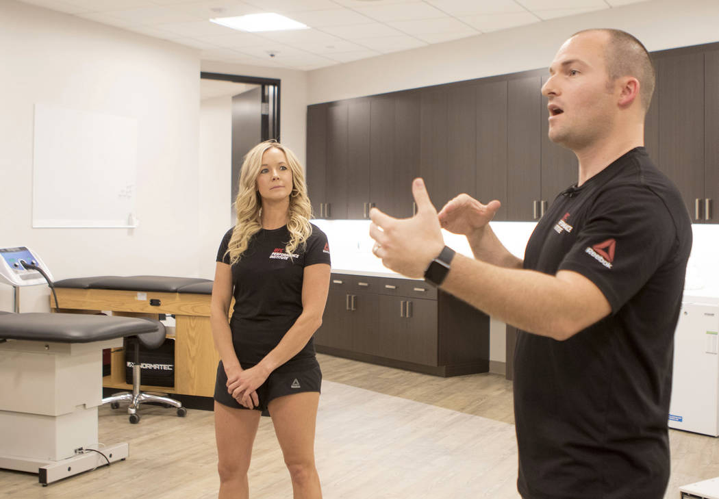 UFC Performance Institute Vice President of Operations James Kimball, right, gives a tour of the new facility in Las Vegas with physical therapist Heather Linden on Friday, May 19, 2017. Heidi Fan ...