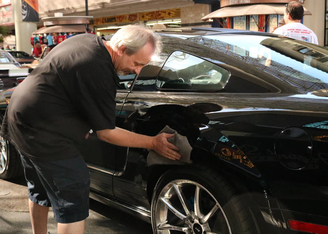 """Ted Sands buffs up the car from the 2009 reboot of """"Knight Rider"""" before the parade gets underway for CarStars at the Fremont Street Experience, Friday, May 19, 2017. Gabriella B ..."""