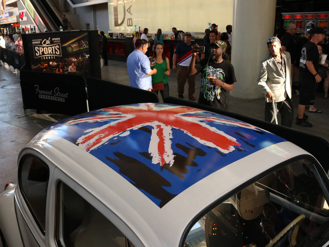 Tourists at the Fremont Street Experience stop to look at the cars on display for CarStars, Friday, May 19, 2017. Gabriella Benavidez Las Vegas Review-Journal @latina_ish