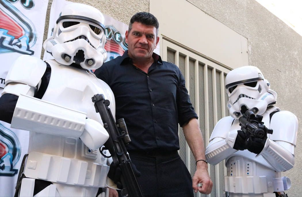 "Spencer Wilding, center, known for playing Darth Vader in ""Rogue One: A Star Wars Story"" poses with Stormtroopers at CarStars at the Fremont Street Experience, Friday, May 19, 20 ..."