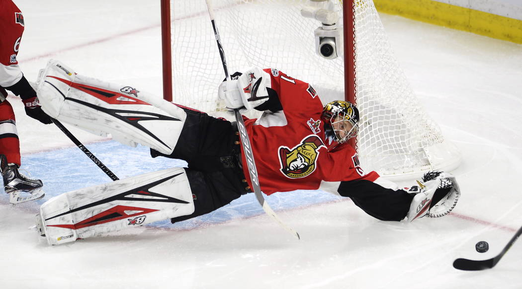 Ottawa Senators goalie Craig Anderson (41) dives to make a save against the Pittsburgh Penguins during the third period of Game 4 of the NHL hockey Stanley Cup Eastern Conference finals, Friday, M ...