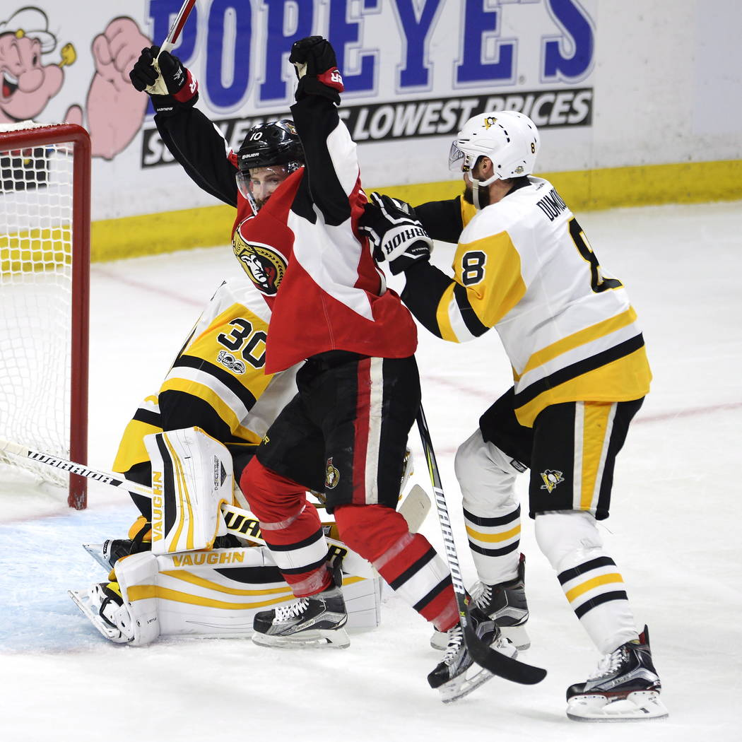 Ottawa Senators center Tom Pyatt (10) celebrates his goal on Pittsburgh Penguins goalie Matt Murray (30) as Penguins defenseman Brian Dumoulin (8) reacts during the third period of Game 4 of the N ...