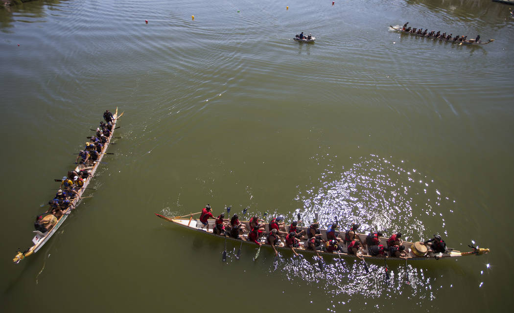 Dragon boat teams return to their docks after competing in a race during the Nevada International Dragon Boat Festival at Lake Las Vegas in Henderson on Sunday, May 21, 2017. Richard Brian Las Veg ...