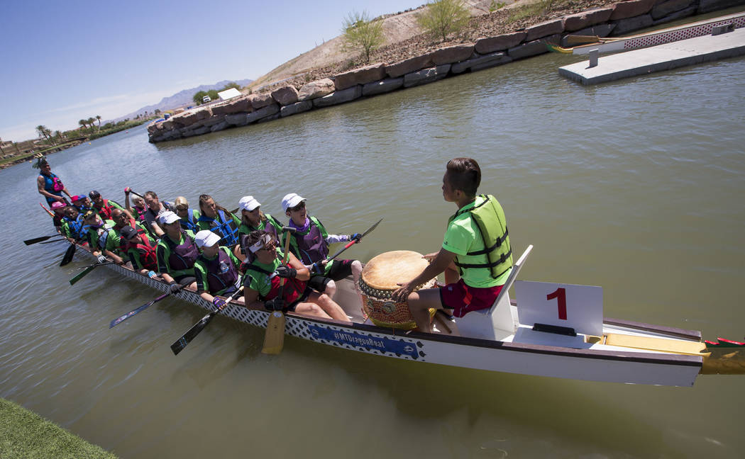 Members of the Flyin Blind dragon boat race team leave the dock as they prepare to participate in a race during the Nevada International Dragon Boat Festival at Lake Las Vegas in Henderson on Sund ...