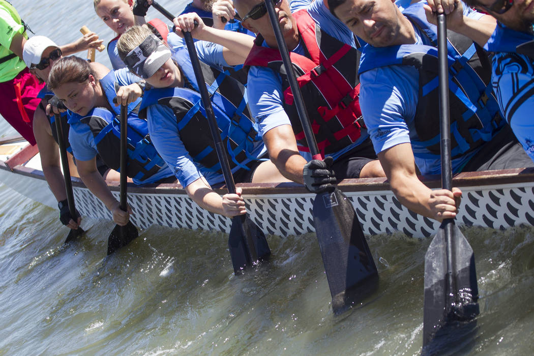Members of the LV Paddle Warriors dragon boat race team prepare to participate in a race during the Nevada International Dragon Boat Festival at Lake Las Vegas in Henderson on Sunday, May 21, 2017 ...