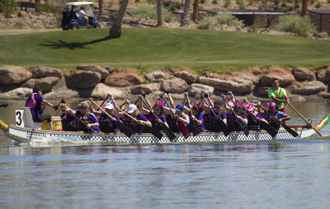 Dragon boat team Catch the Rah Rahs participate in a race during the Nevada International Dragon Boat Festival at Lake Las Vegas in Henderson on Sunday, May 21, 2017. Richard Brian Las Vegas Revie ...